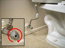 Shut off toilet valve to prevent overflowing